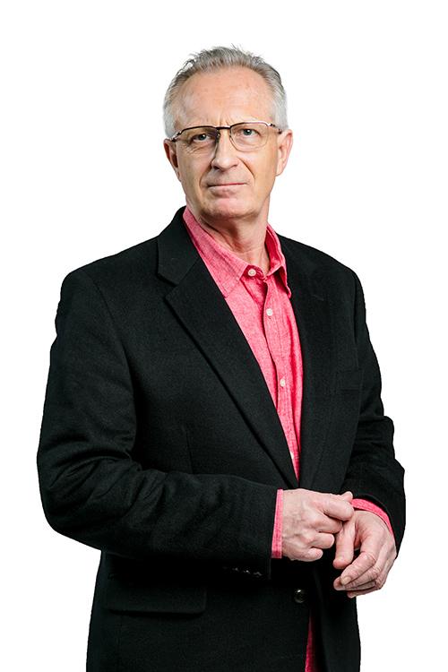 Chris Linscheid wearing a pink button down shirt and black blazer